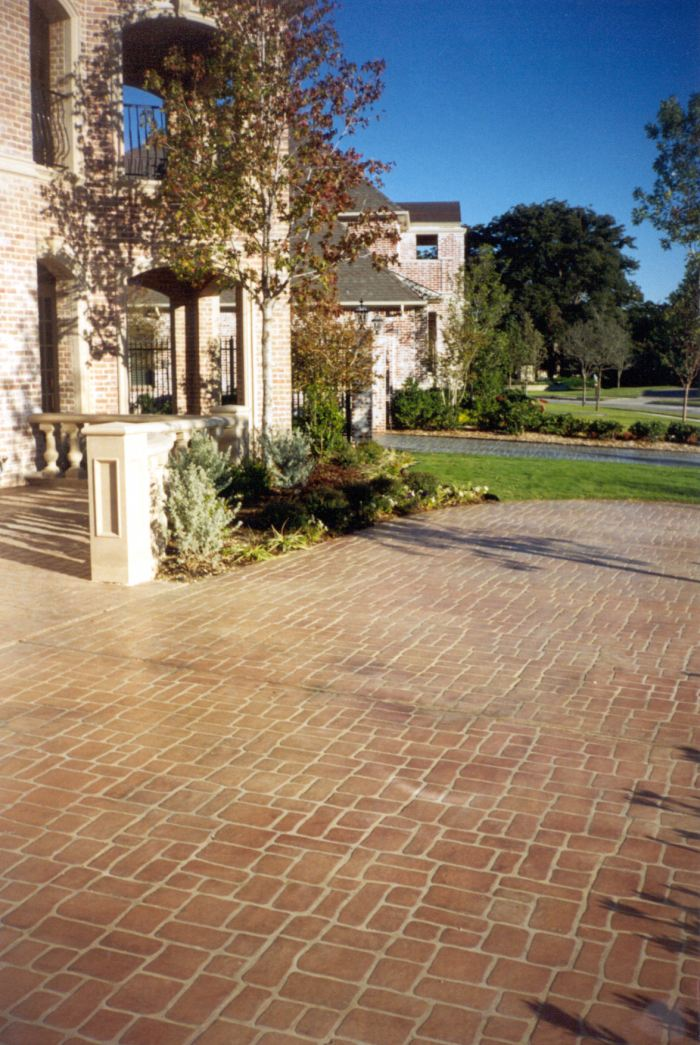 Stenciled concrete can be used in large spaces to break up the monotony of plain concrete.