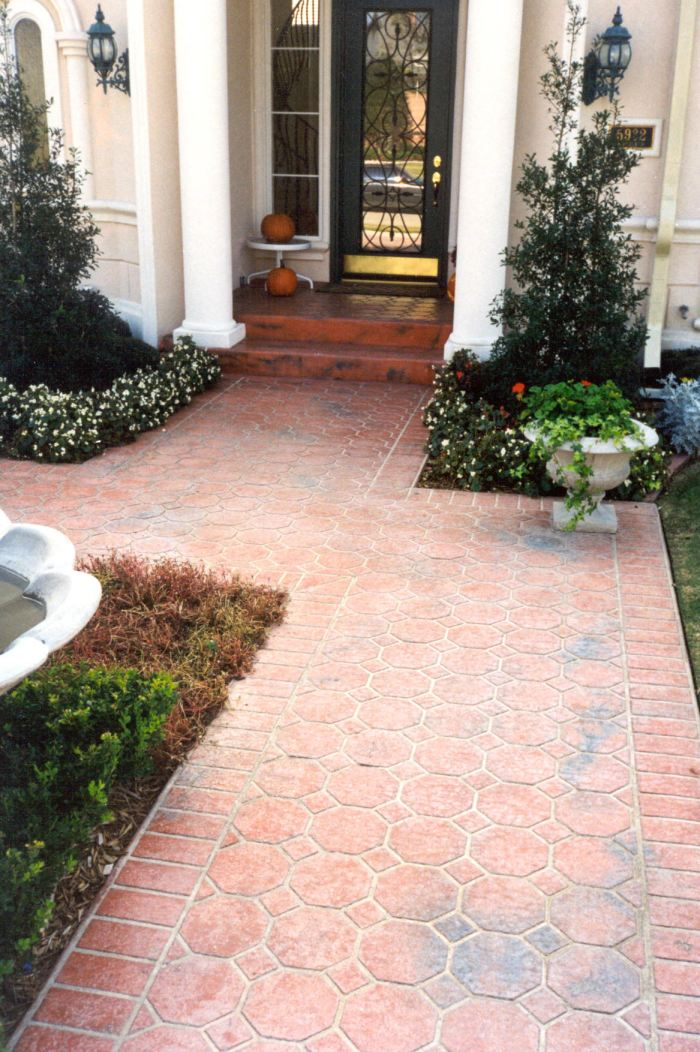 Showing how coloring stenciled concrete can really add to the natural look.