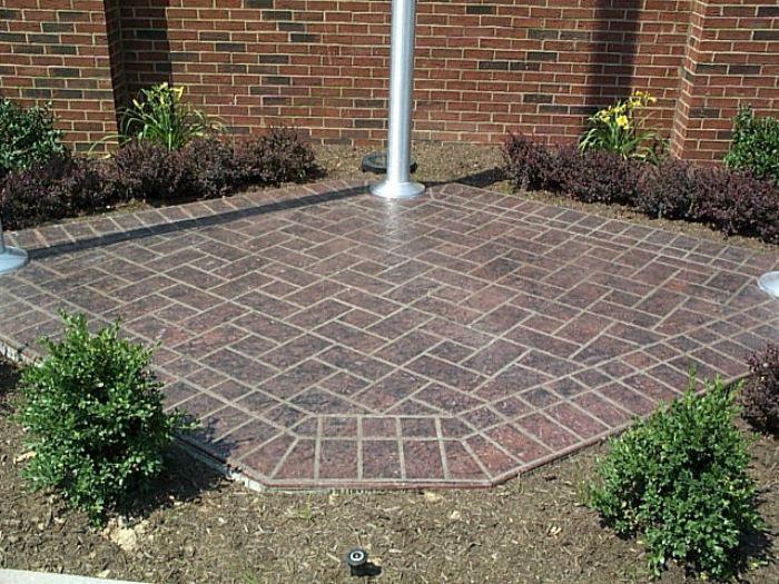 Outdoor patio that has been stenciled for a rustic look.