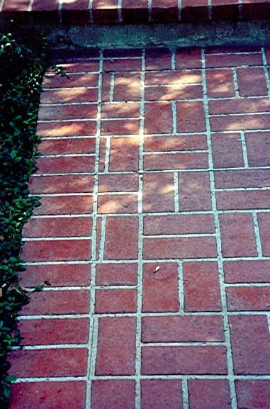 Concrete stencils give this patio a faux brick look.
