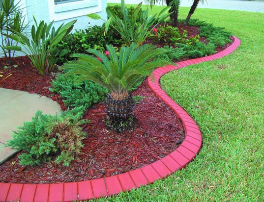 Concrete curbing in bright red to make it look like brick pavers but it is one continuous concrete piece.