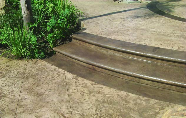 Brownish concrete steps create a very natural look that blends in well with this outdoor patio.