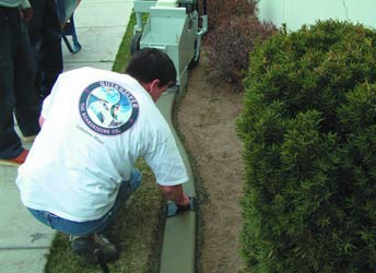 Pack the dirt to prepare the subgrade as needed for the decorative concrete curbing.