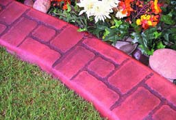 Concrete curbing that looks like red brick with colored grout lines.