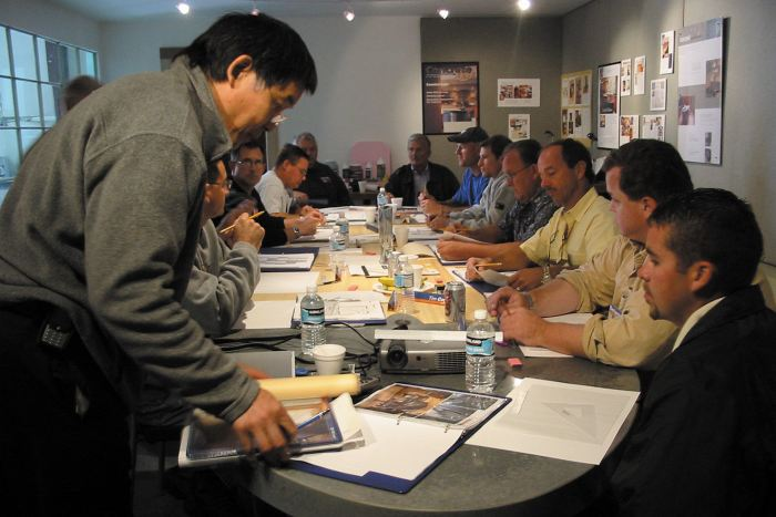 Fu-Tung Cheng training an eager group of students about the topic of concrete countertops.