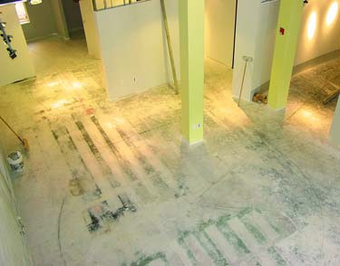 Process photo of a floor removal and then concrete staining job.