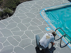 Stenciling a swimming pool concrete deck to take on a look and feel of real stone.