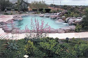 faux rock made of concrete surround swimming pool - Faux rock also allows the contractor to shape a stream of water to an extent that is hard to do with natural rock, Riley says. When water cascades over a lip of natural rock, it typically curls over the edge.