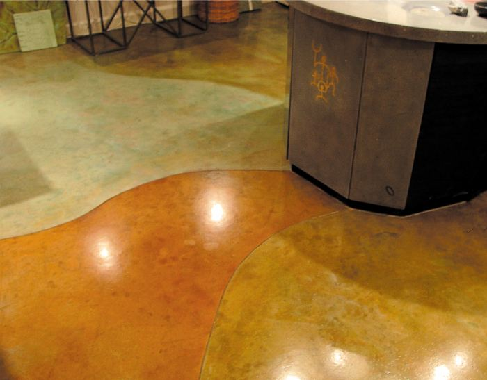Lokahi Stone - Polished and dyed concrete floor has a ray of earth tone colors moving from the concrete island bar.