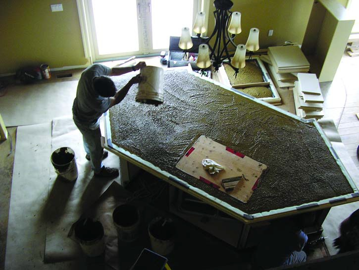 Precast concrete countertop process photo in kitchen, trapezoid shaped.