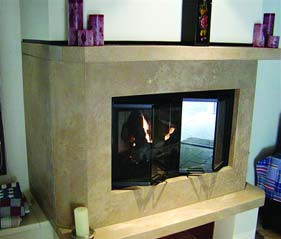 Taller than normal concrete fireplace surround is open to view the fire on two sides.