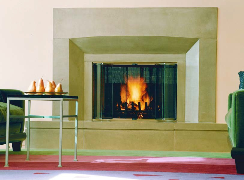 Elegant fireplace surround made of concrete in an upscale sitting room.