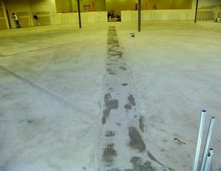 Patching concrete prior to installation of a seamless floor coating.