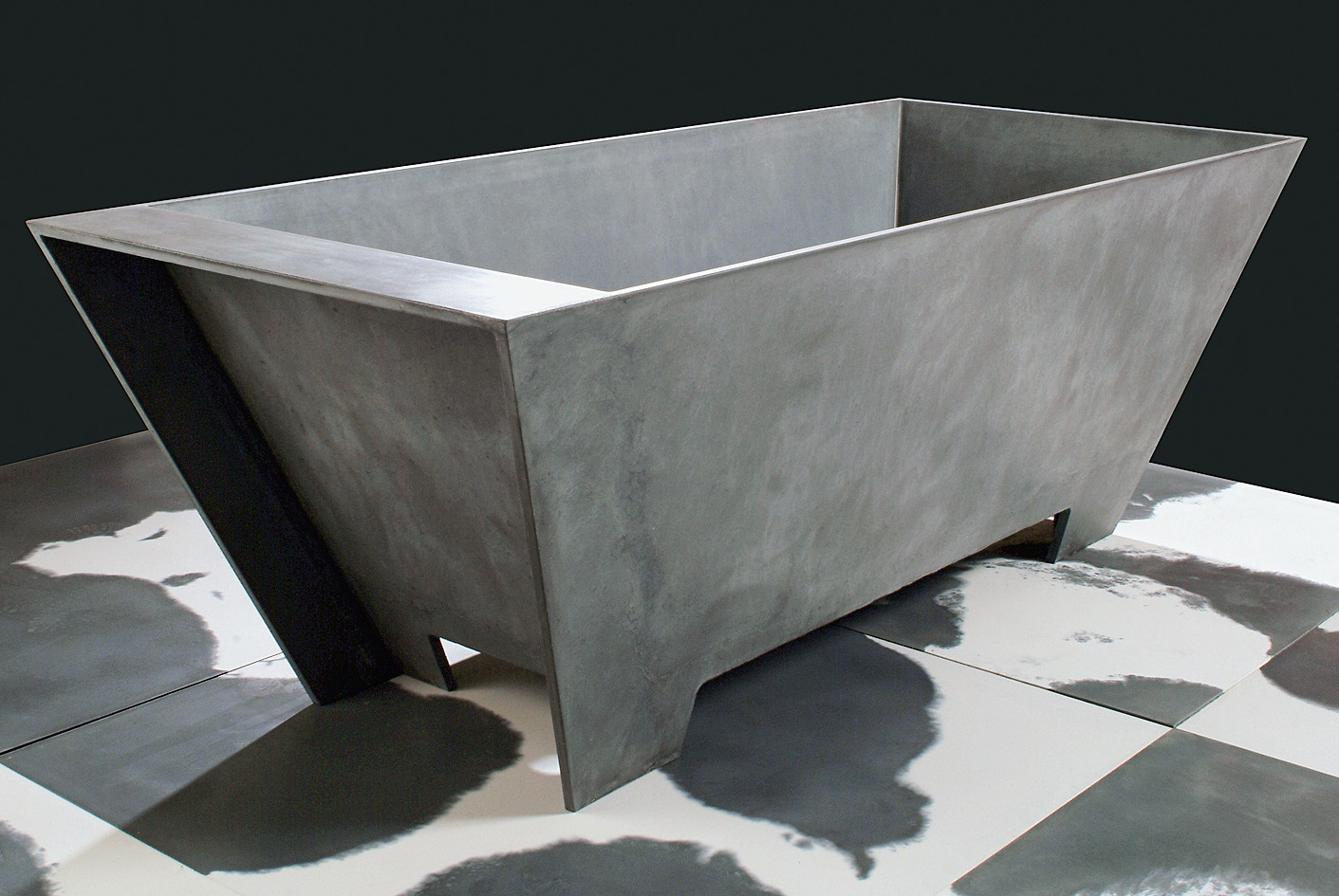 The low permeability and high durability of Ductal makes it an intriguing material for plumbing fixtures. As shown by this tub designed by Francesco Passaniti, the thin sections provide sculptural opportunities not possible with thick concrete tubs or washbasins.