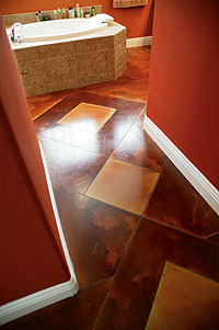 Floor Seasons - diamond shapes cut into a hall way stained a lighter color tan next to a deep rich brown. acid stained concrete
