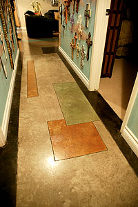 A hallway stained in four hues of brown using acid stain. The walls in the hall way are covered in crosses.