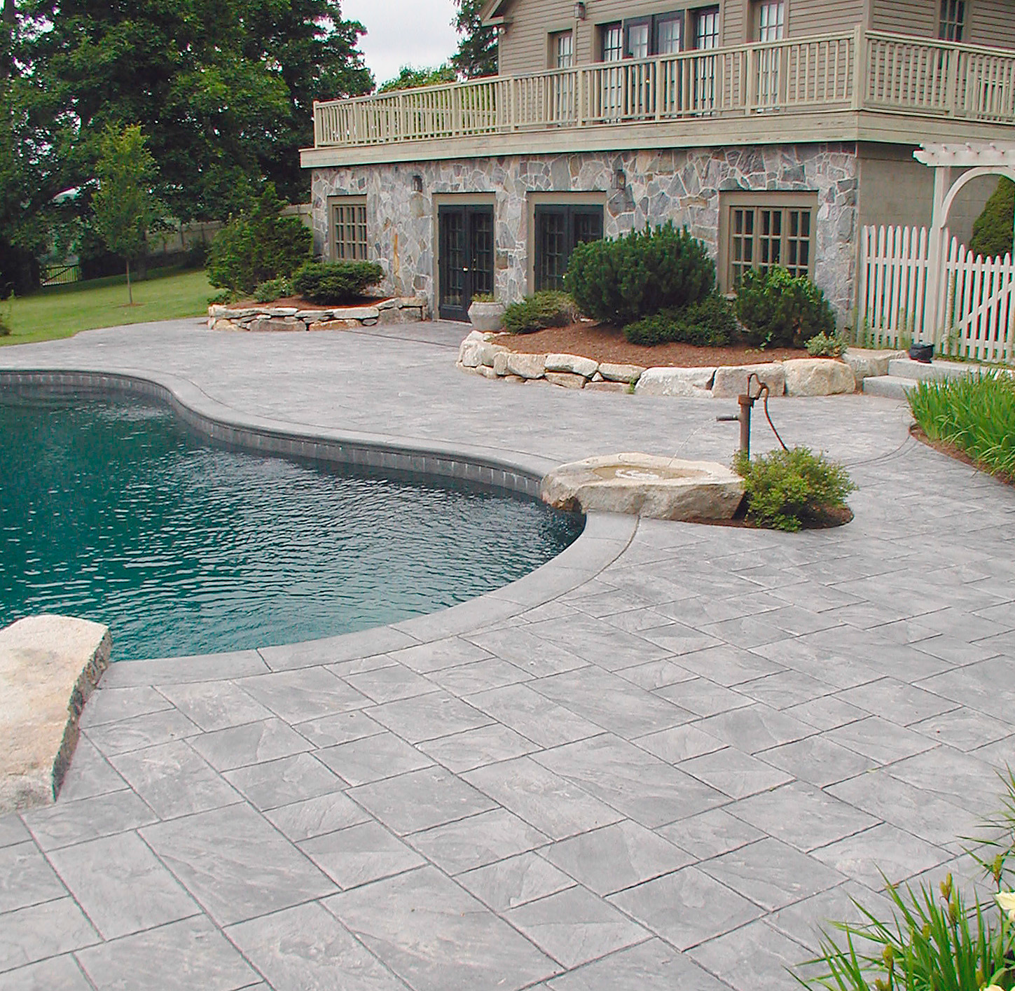 This pool deck has withstood Maine winters for seven years, and it still looks as good as new.
