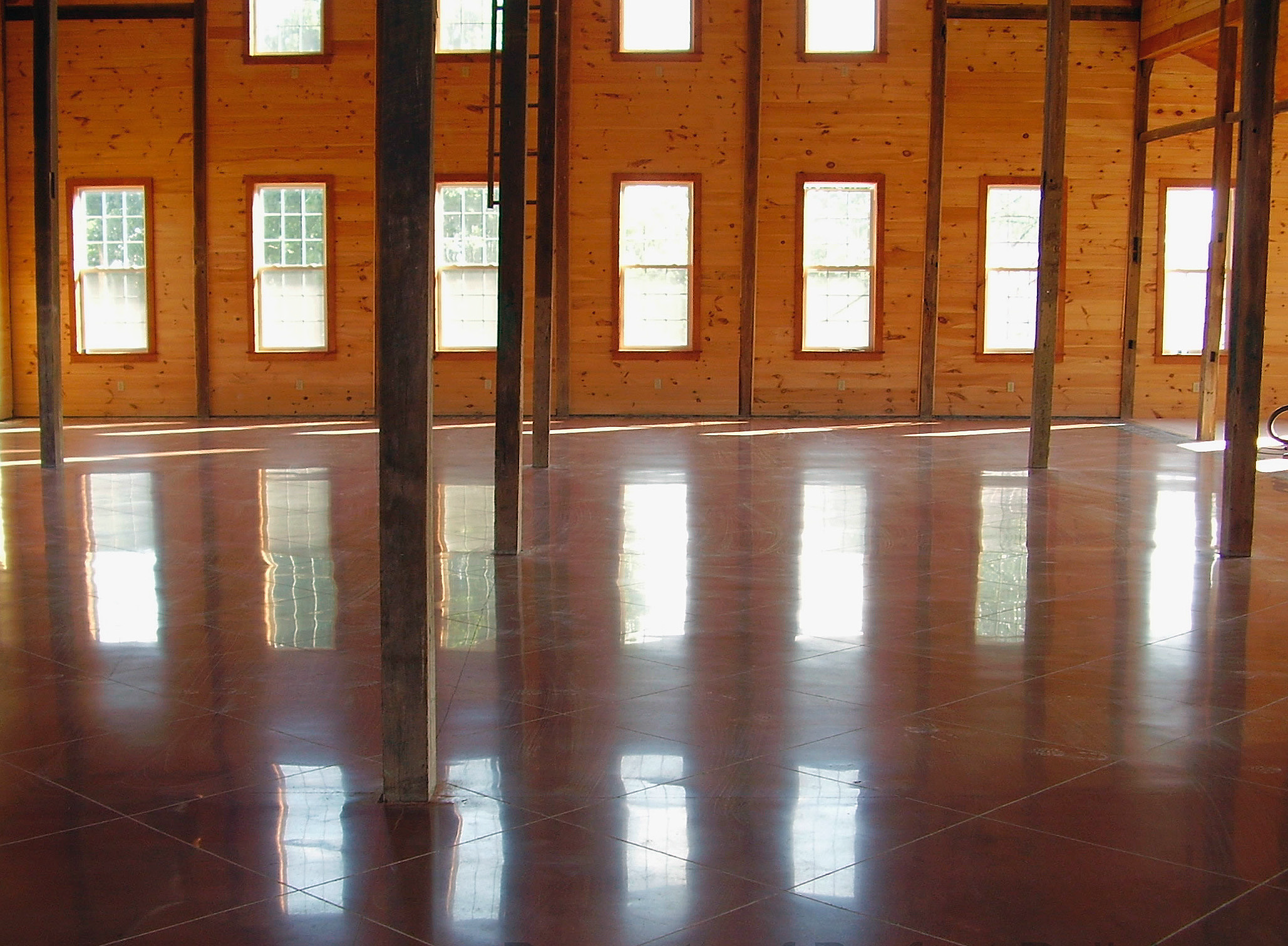 Polished concrete was used for more than 5,000 square feet of the nearly 7,800-square-foot facility. The floors are colored Indian red, with 2-foot by 2-foot panels scored on the diagonal.