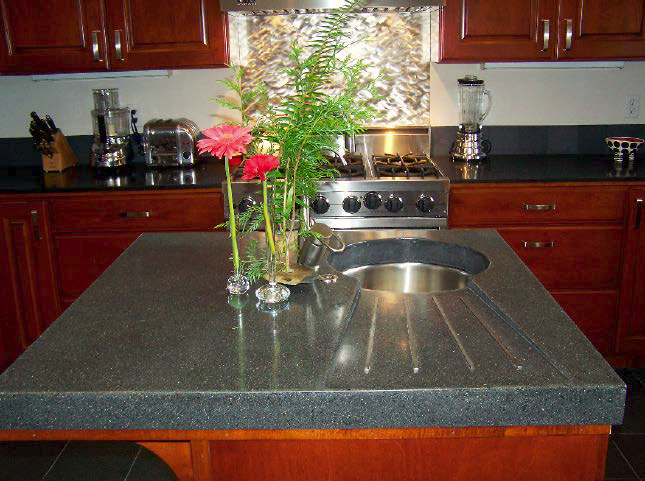 Concrete countertop with built in drain board.
