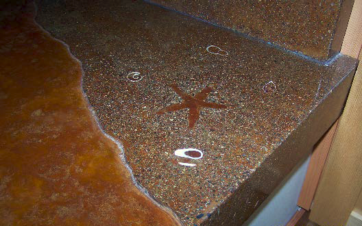 Adding small details like this star fish design to countertop creates unique art.