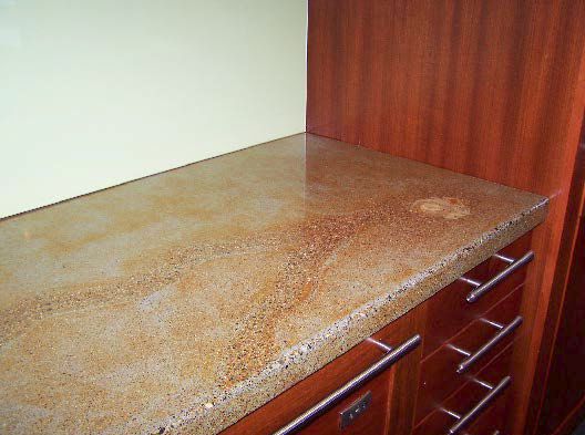 A look at a concrete countertop used as a desk.