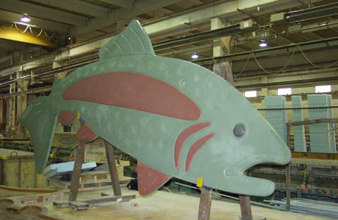 The large lightweight concrete trout being fabricated in the warehouse for transit