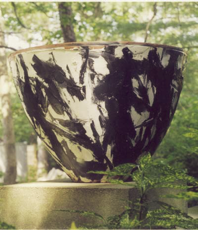 Black and white painted concrete pot