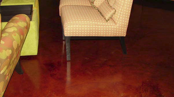 Rich red color has been stained using concrete stains in this home that is filled with decorative concrete.