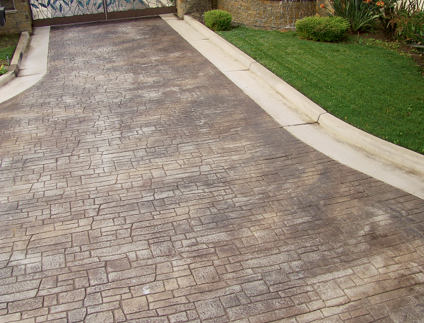 Stamped concrete driveway colored with dust-on color hardener