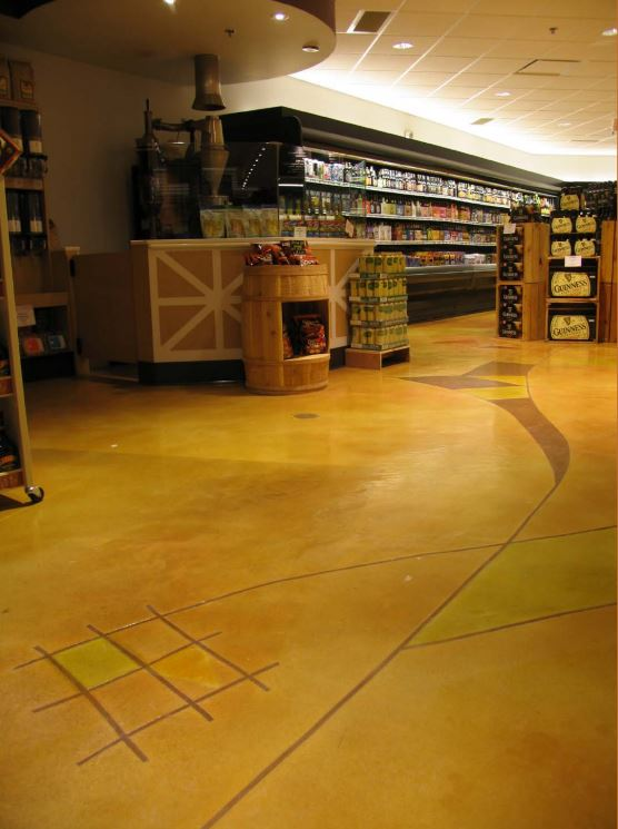 A supermarket with a stained concrete floor.