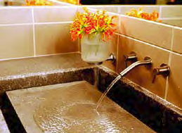 A concrete sink with water filling the basin.