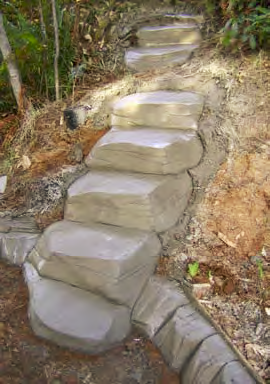natural stones that take the shape of steps up the side of a mountain achieved using shotcrete.