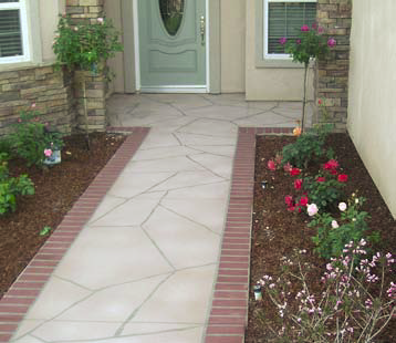 Walkway to a front door has been given a treatment to look like stone and brick.