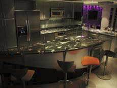 Countertop in a kitchen thath as been embedded with fiber options and other elements.