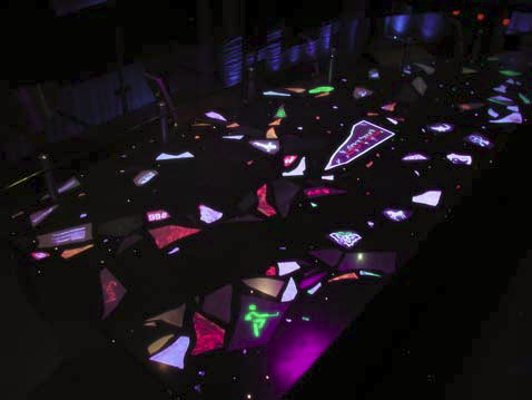 "The fiber-optic display has three modes: a daytime phase with only the white glass and mirror showing, a romantic mood-setting phase that only shows the Illumi-Crete stars, and a ""total party"" phase in which the fiber optics and black lights pulsate to music being played"