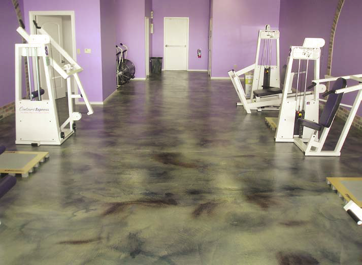 This fitness room has been decked out with acid stained concrete.
