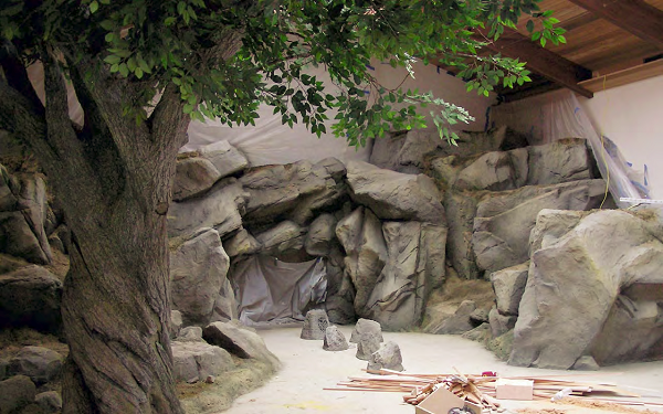 This natural-looking setting under a GFRC tree will display hunting trophies for the homeowner.