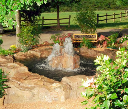 A water feature placed outdoors using coloring and carving techniques takes on a natural look.
