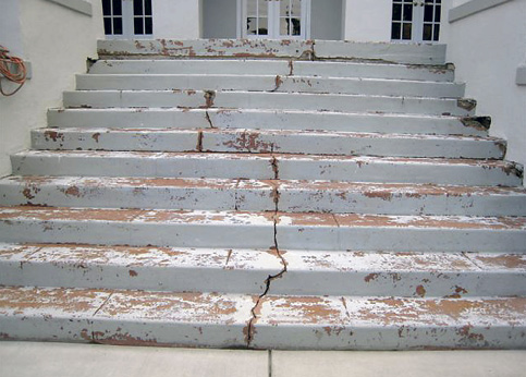 Cracked and chipped exterior concrete steps.