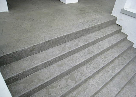 Another comparison shot of the decorative concrete restoration done to these concrete steps.
