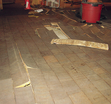 The torn up floor boards in this museum were a prime candidate for concrete restoration,