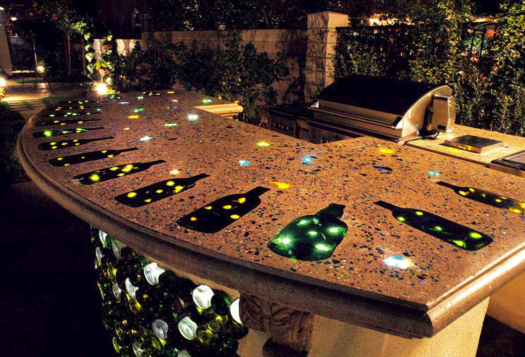 Concrete countertop outside that has been lit with fiber optics.