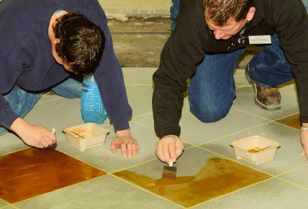 Students in a Dealer Training Class at Legacy Decorative Concrete Systems headquarters apply Tinté D'Acqua stains over Venetian MicroTop.