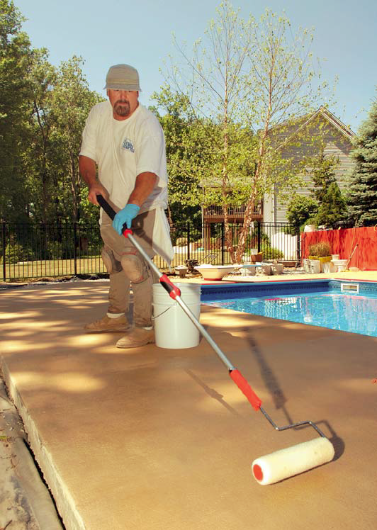 Smith Paints' Hugh Monteith rolls a two-component sealer over a pool deck colored with CF-250 Desert Sand and CF-700 Fawn highlights.
