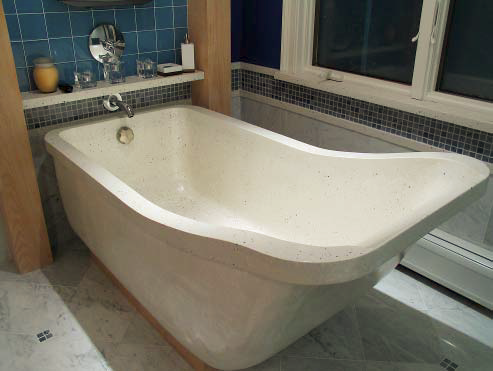 Large concrete tub with a high back for easy relaxing.