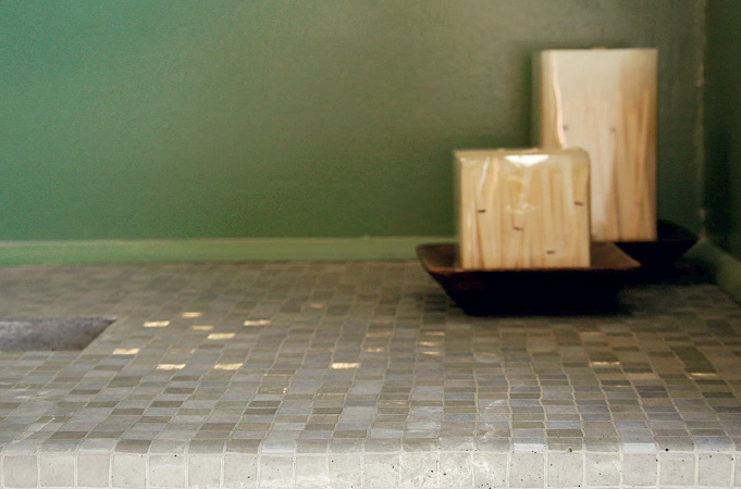 Casting mat placed on a concrete countertop gives a shimmered tile effect.