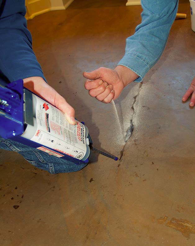 10 Minute Concrete Mender and fine-grade sand are added to hairline cracks on a decorative concrete floor.