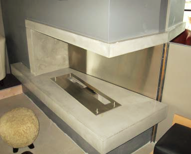 Concrete fireplace insert that can be viewed from both sides and add ambiance to the room.