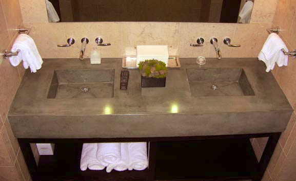 Double sink vanity made with concrete and colored in sleek gray.