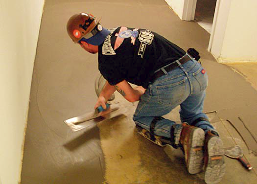 SkimCrete XL, from Dependable Floor Products, is being applied here as part of the company's Moisture Suppressant System.